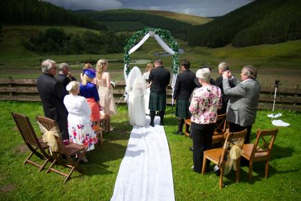 Couple with archway - small Scottish wedding